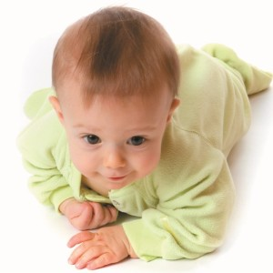 Crawling Baby in Green PJs (isolated)