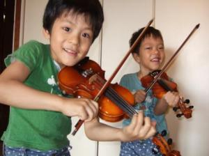 Twins Playing Violin